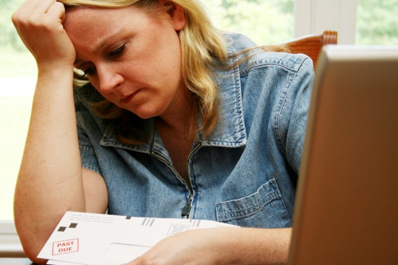 In Debt? 4 Ways to Get Out Fast