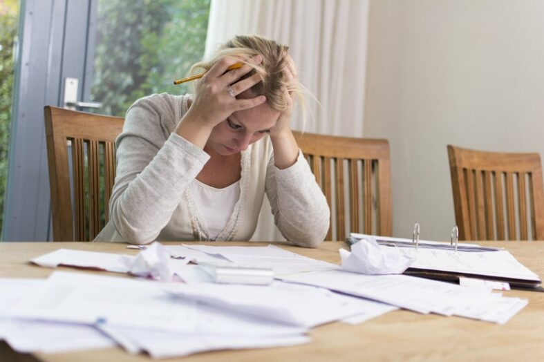 5 Reasons People Stay in Debt
